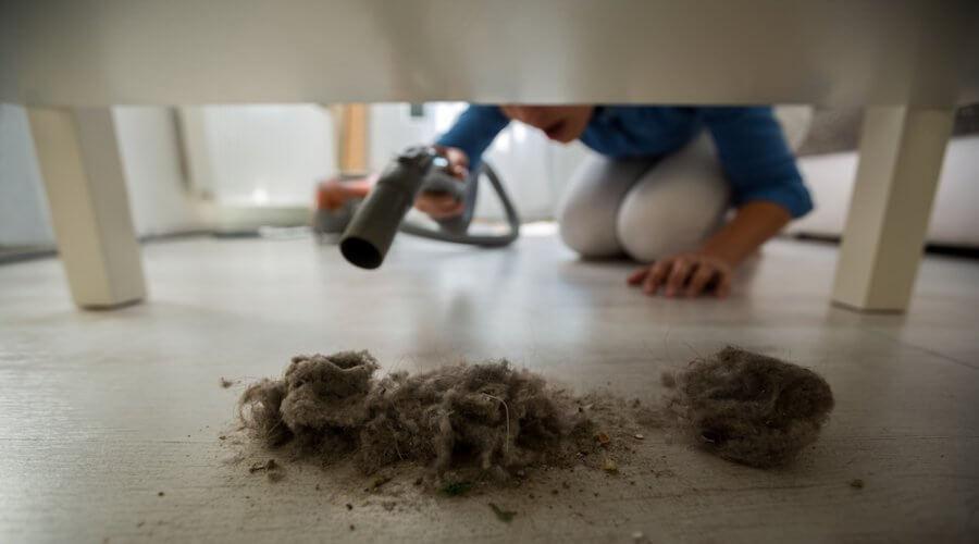 housekeeper vacuuming